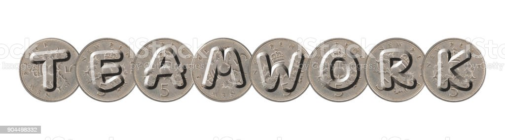 TEAMWORK word with old coins on white background stock photo