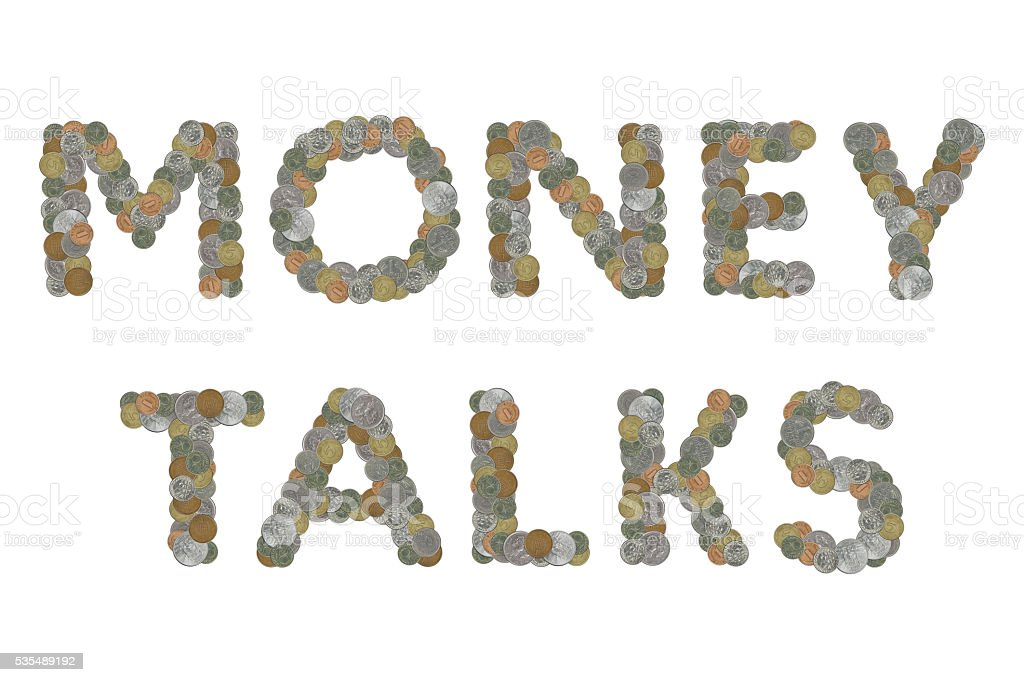 MONEY TALKS word with Old Coins stock photo