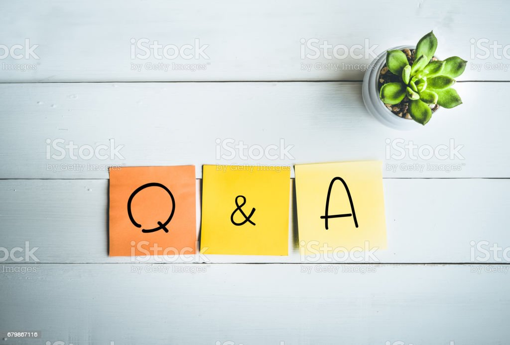 Q & A word with paper note on wood table stock photo