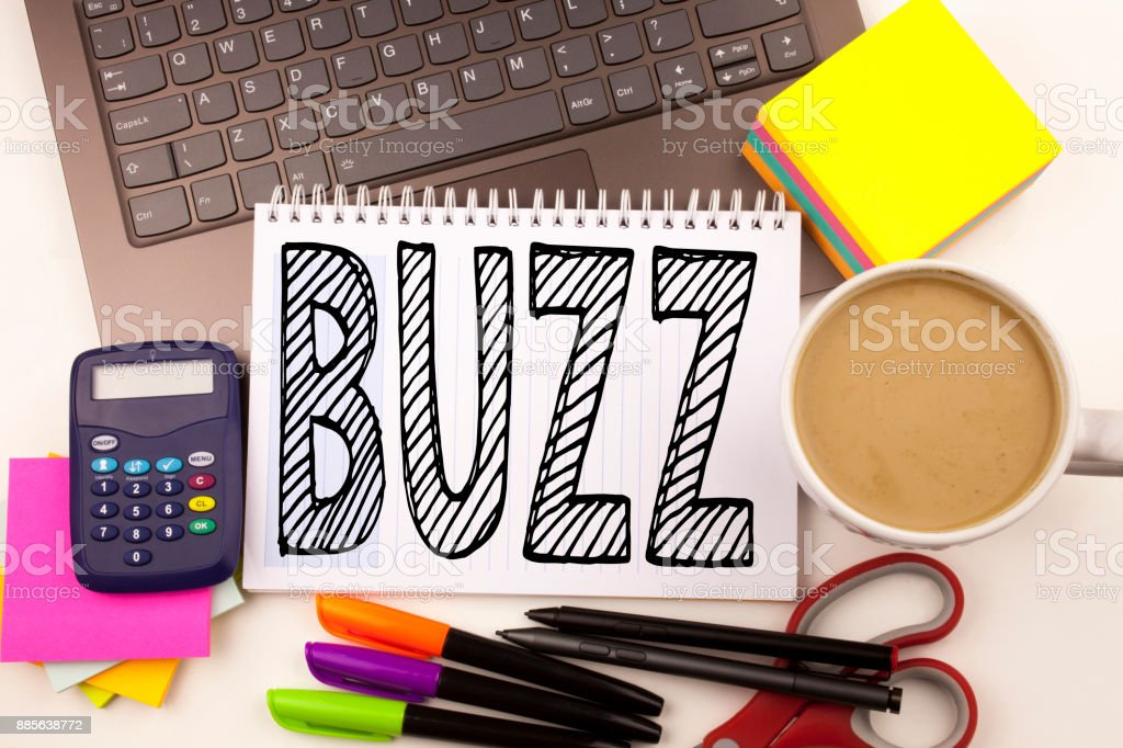 Word writing Buzz in the office with laptop, marker, pen, stationery, coffee. Business concept for Buzz Word llustration Workshop white background with copy space stock photo
