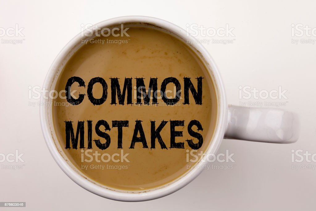 Word, writing Common Mistakes text in coffee in cup. Business concept for Common Decision Mistakes on white background with copy space. Black text with red word. stock photo