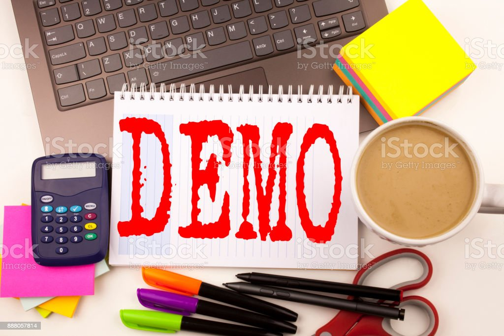 Word writing Demo in the office with  laptop, marker, pen, stationery, coffee. Business concept for Software Demonstration Workshop white background with copy space stock photo