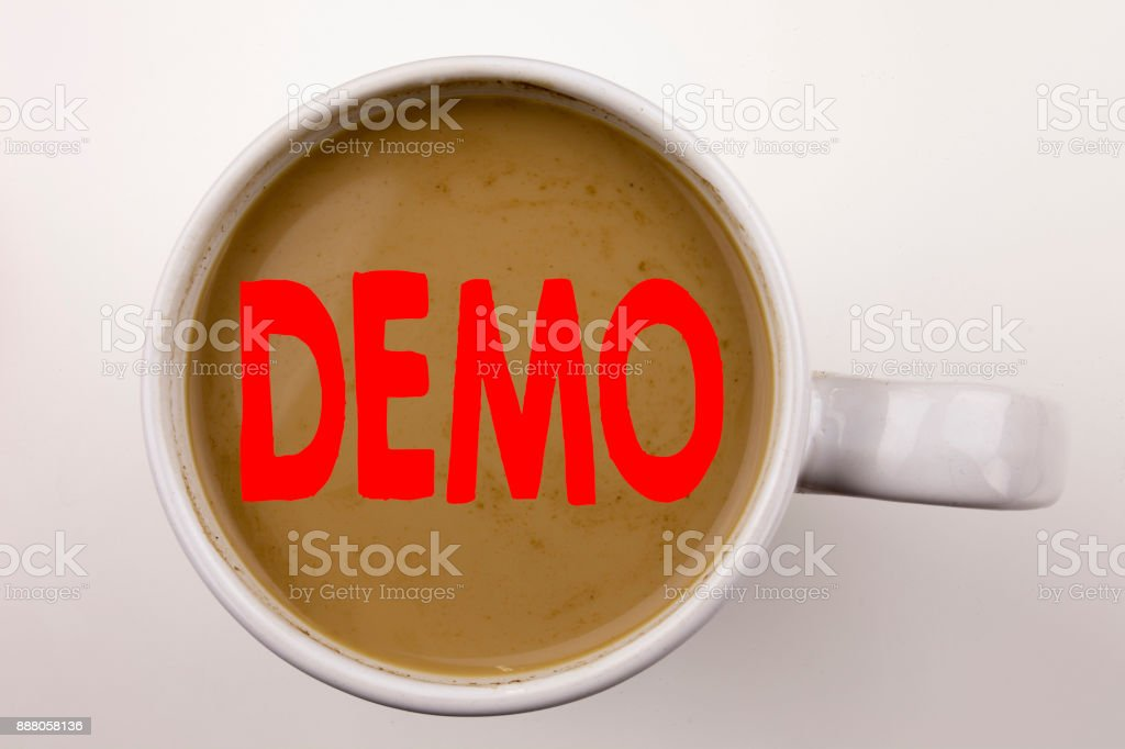 Word, writing Demo text in coffee in cup. Business concept for Software Demonstration on white background with copy space. Black text with red word. stock photo