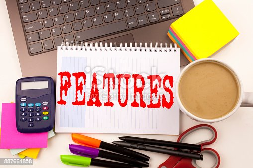 istock Word writing Features in the office with  laptop, marker, pen, stationery, coffee. Business concept for Advertisement Advertising Workshop white background with copy space 887664858