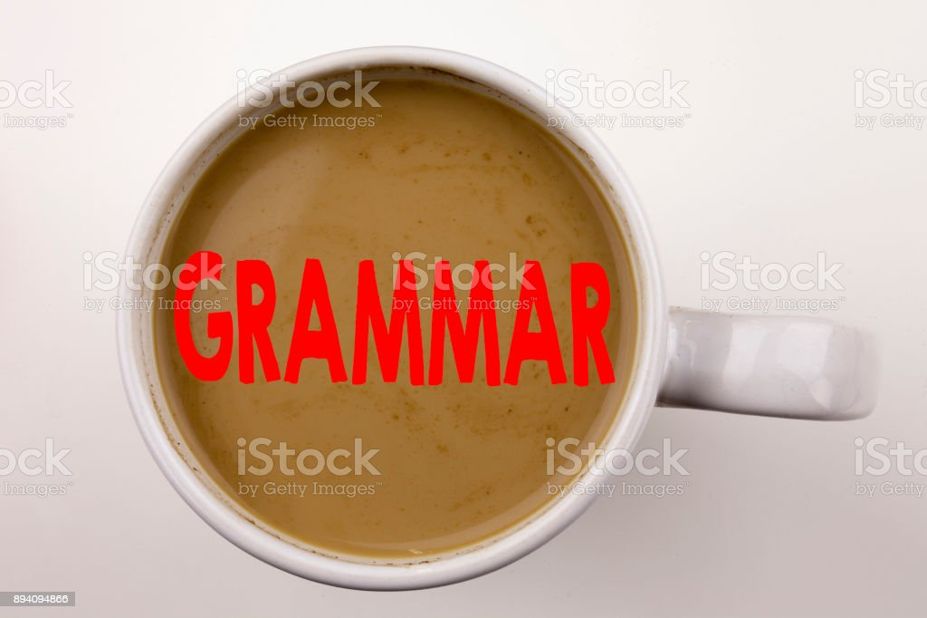 Word, writing Grammar text in coffee in cup. Business concept for  The Basic Rules of Syntax Grammatical Language on white background with copy space. Black text with red word. stock photo