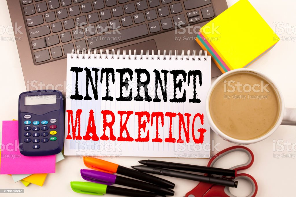 Word writing Internet Marketing in the office with surroundings such as laptop, marker, pen, stationery, coffee. Business concept for Technology Strategy Design Workshop white background with copy space stock photo