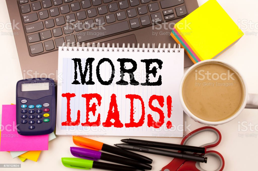 Word writing More Leads in the office with surroundings such as laptop, marker, pen, stationery, coffee. Business concept for Get More Leads Consumer Marketing Workshop white background with copy space stock photo