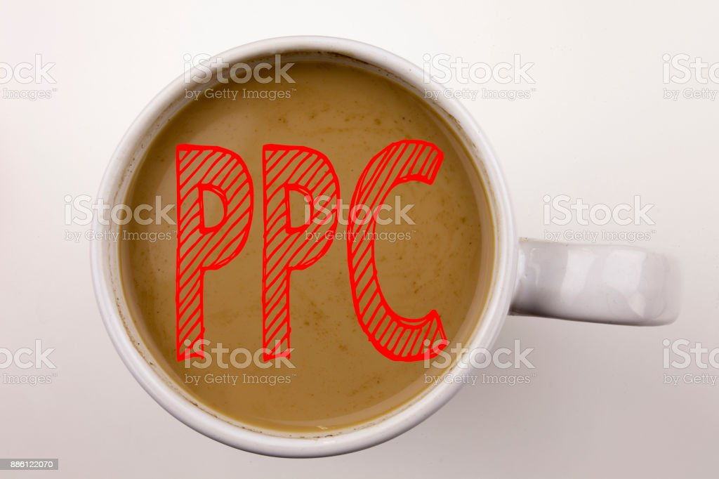 Word, writing PPC - Pay per Click text in coffee in cup. Business concept for Internet SEO Money on white background with copy space. Black text with red word. stock photo