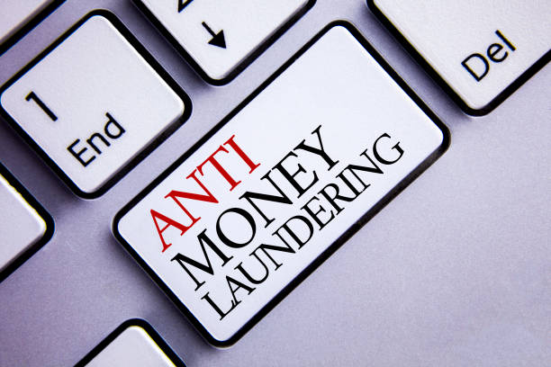 Word writing text Anti Monay Laundring. Business concept for entering projects to get away dirty money and clean it written on White Keyboard Key with copy space. Top view. stock photo