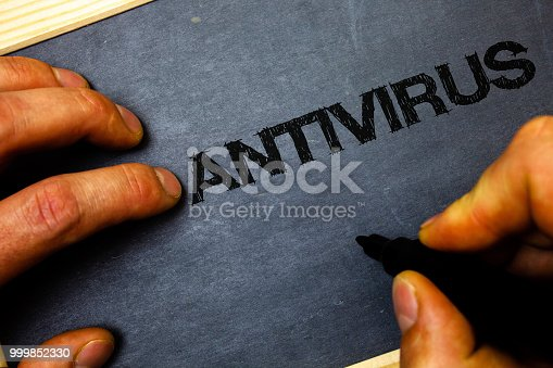 812847754 istock photo Word writing text Antivirus. Business concept for Safekeeping Barrier Firewall Security Defense Protection Surety Man hold holding black marker markers notebook wood wooden background. 999852330