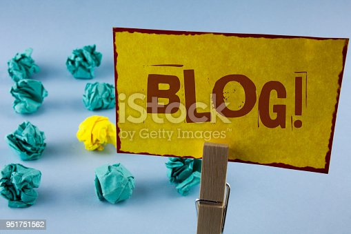 istock Word writing text Blog Motivational Call. Business concept for Preperation of Attractive content for blogging websites written on Yellow Sticky Note Paper in Clip on the plain background Paper Balls 951751562