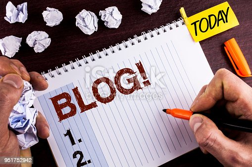 istock Word writing text Blog Motivational Call. Business concept for Preperation of Attractive content for blogging websites written by Man on Notepad on wooden background holding Marker Today Paper Balls. 951752942