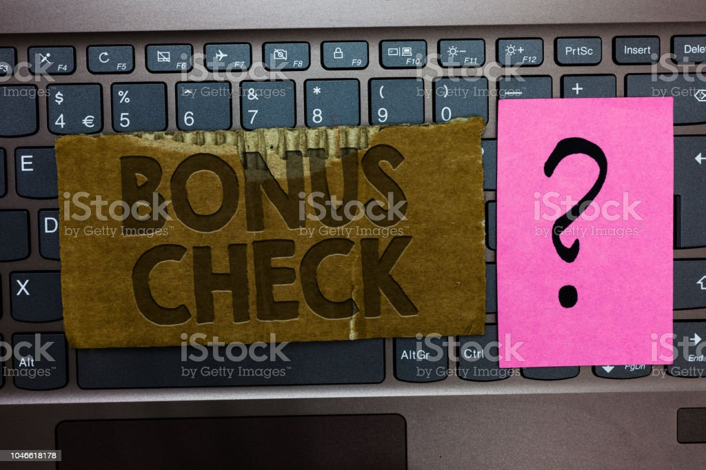 Word writing text Bonus Check. Business concept for something in addition to what is expected or strictly due Paperboard Keyboard Question sign paper Communicate Doubts Type computer. stock photo