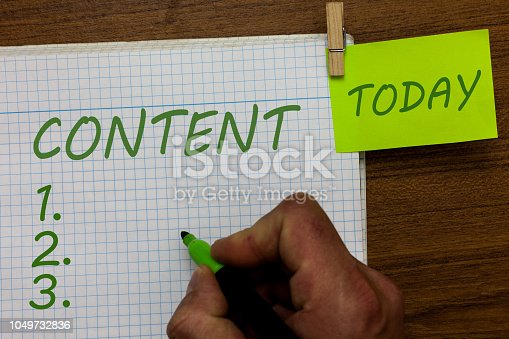 istock Word writing text Content. Business concept for Things included in something Marketing material State of happiness Man holding marker notebook clothespin hold reminder wooden background. 1049732836
