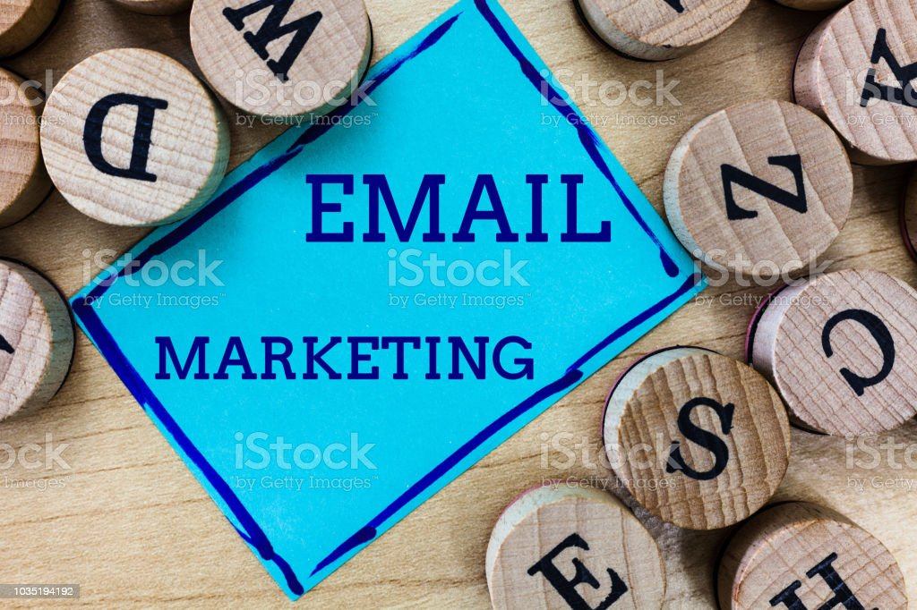 Word writing text Email Marketing. Business concept for Sending a commercial message to a group of people using mail stock photo