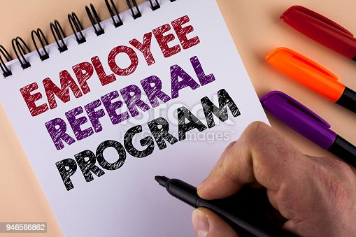istock Word writing text Employee Referral Program. Business concept for Recommend right jobseeker share vacant job post written by Man with Marker on Notepad on the plain background Markers next to it 946566862