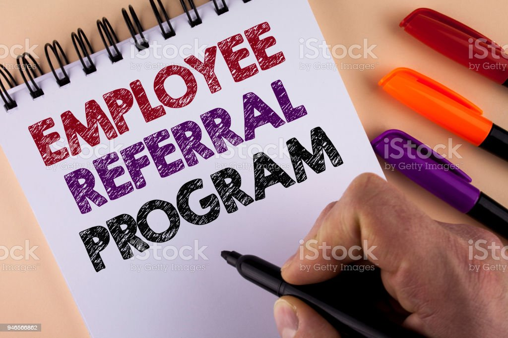 Word writing text Employee Referral Program. Business concept for Recommend right jobseeker share vacant job post written by Man with Marker on Notepad on the plain background Markers next to it stock photo