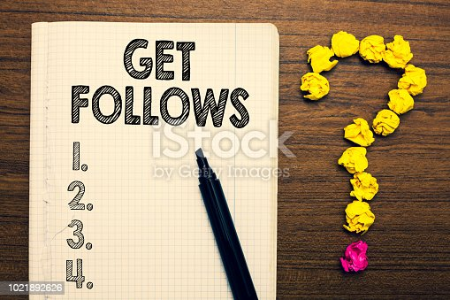 istock Word writing text Get Follows. Business concept for person who imitates copies or takes as model ideal person Notebook marker crumpled papers forming question mark wooden background. 1021892626
