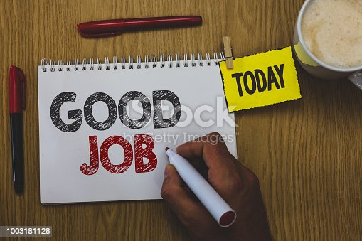 istock Word writing text Good Job. Business concept for encourage someone for his effort hard work winning or success Man holding marker notebook wooden table for today important coffee cup. 1003181126