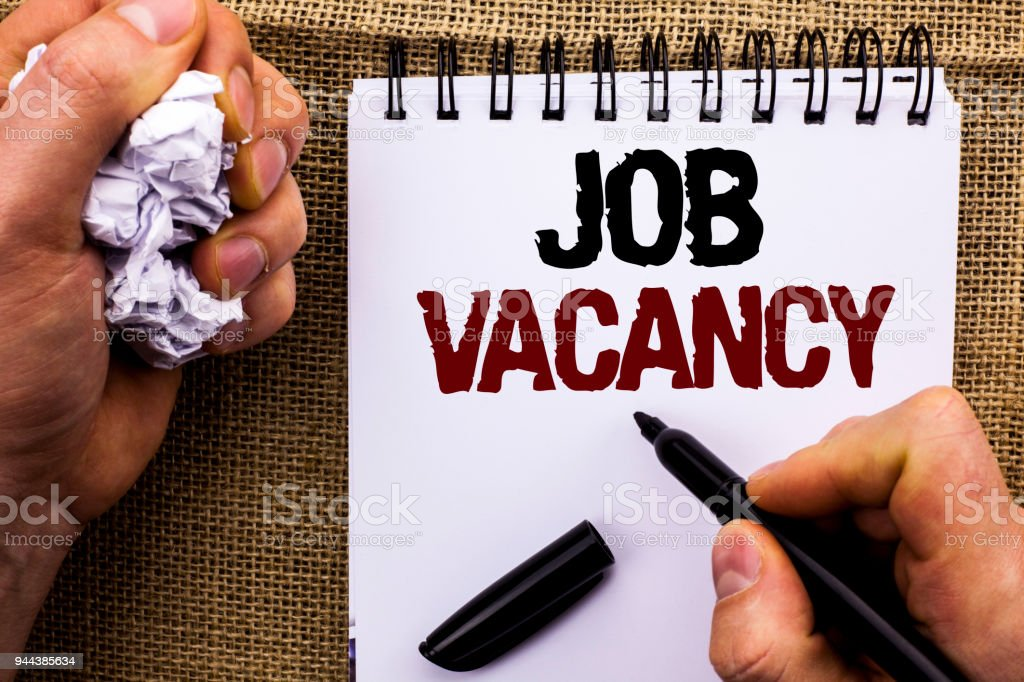 Word writing text Job Vacancy. Business concept for Work Career Vacant Position Hiring Employment Recruit Job written by Man Holding Marker on Notebook Book on the jute background. stock photo