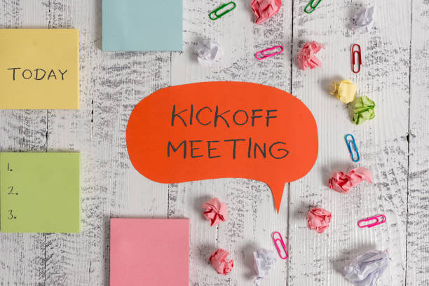 Word writing text Kickoff Meeting. Business concept for Special discussion on the legalities involved in the project Blank speech bubble paper balls clips sticky notes old wooden background. stock photo
