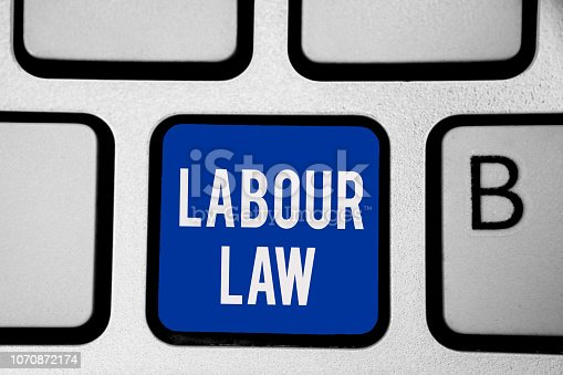 istock Word writing text Labour Law. Business concept for Rules implemented by the state between employers and employee Keyboard blue key Intention create computer computing reflection document. 1070872174