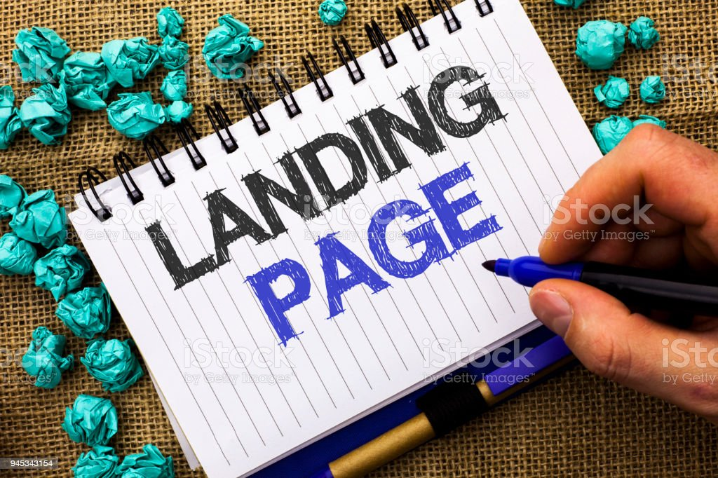 Word writing text Landing Page. Business concept for Website accessed by clicking a link on another web page written by Man Holding Marker on Notebook Book on the jute background. stock photo