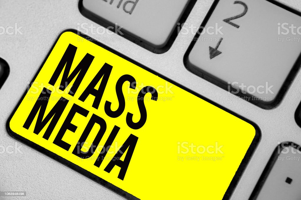 Word writing text Mass Media. Business concept for Group people making news to the public of what is happening Keyboard yellow key Intention create computer computing reflection document. stock photo