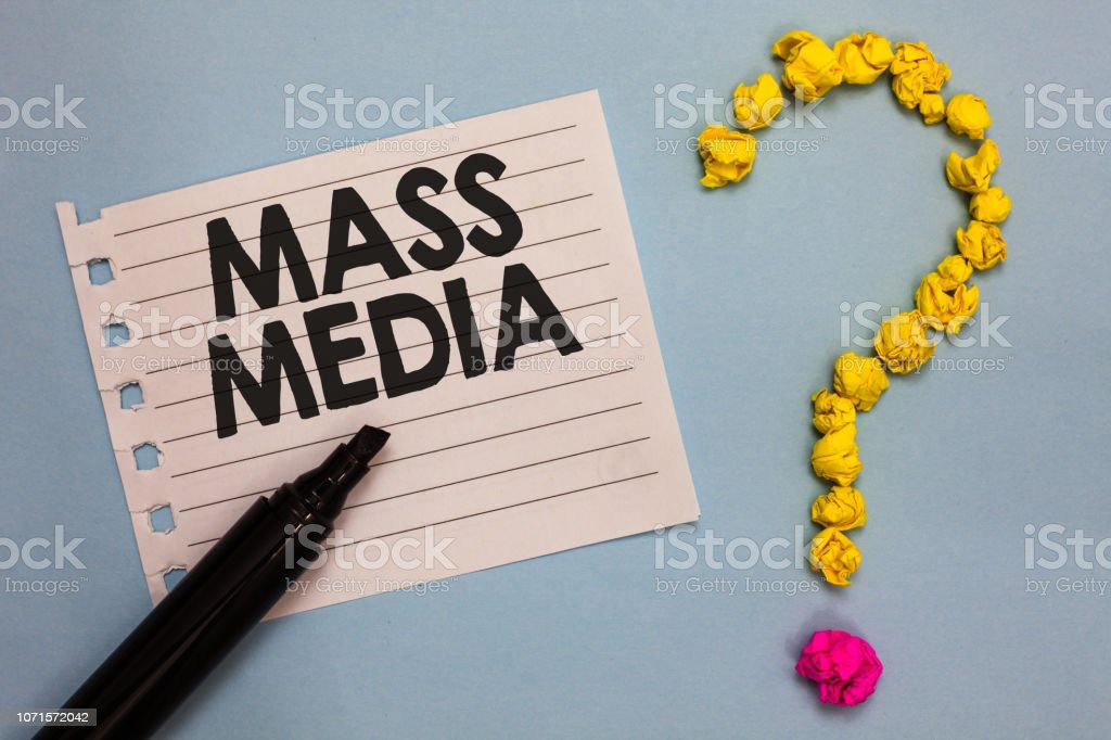 Word writing text Mass Media. Business concept for Group people making news to the public of what is happening Paper marker crumpled papers forming question mark wooden background. stock photo