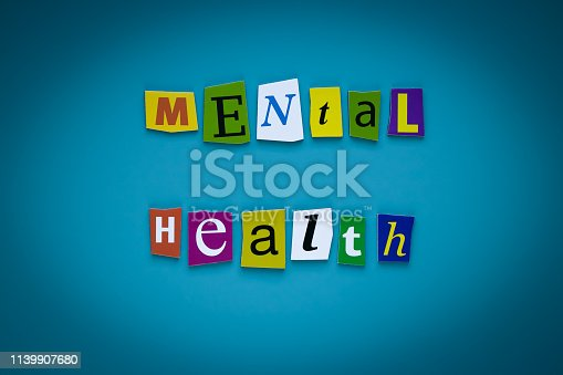 istock A word writing text - mental health - of cut letters on a blue background. Headline - mental health. Banner with inscription - mental health. Psychologic concept. 1139907680