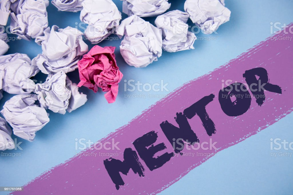 Word writing text Mentor. Business concept for Person who gives advice or support to a younger less experienced written on Painted background Crumpled Paper Balls next to it. stock photo