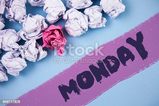 istock Word writing text Monday. Business concept for First day of the week Back to work Weekend is over Wakeup Early written on Painted background Crumpled Paper Balls next to it. 949117828