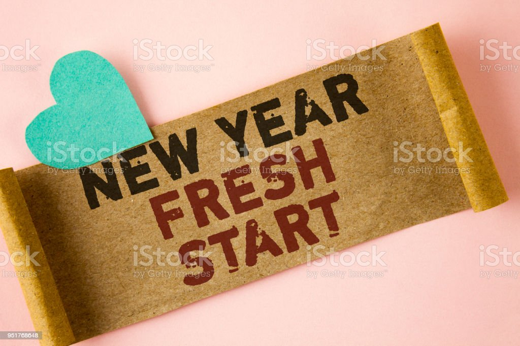 Word writing text New Year Fresh Start. Business concept for Time to follow resolutions reach out dream job written on Folded Cardboard paper piece on plain background Heart next to it. stock photo