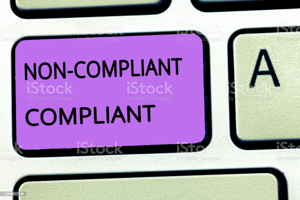 Word writing text Non Compliant Compliant. Business concept for Resistant to the Rule in Accordance to Law stock photo