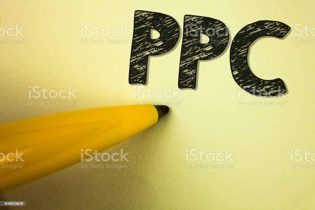 Word writing text Ppc. Business concept for Pay Per Click Advertising Strategies Direct Traffic to Websites written on plain background Pen next to it. – zdjęcie