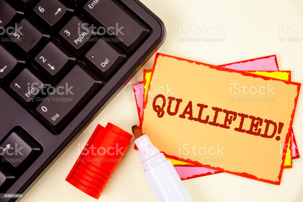 Word writing text Qualified Motivational Call. Business concept for Certified to perform a job Competent Experienced written on Sticky Note paper on plain background Marker and Keyboard next to it. stock photo