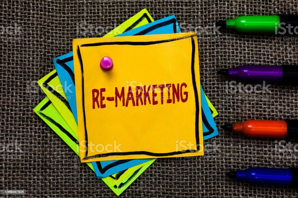 Word writing text Re Marketing. Business concept for Strategy to reach potential customers in your website Paper notes Important reminders Communicate ideas Markers Jute background. stock photo