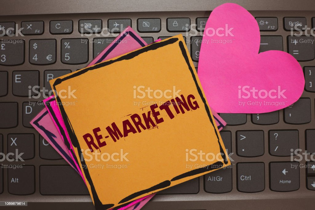 Word writing text Re Marketing. Business concept for Strategy to reach potential customers in your website Papers Romantic lovely message Heart Keyboard Type computer Good feelings. stock photo
