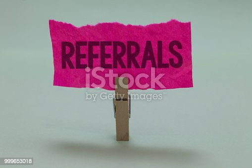 istock Word writing text Referrals. Business concept for Act of referring someone or something for consultation review Light grey colour dark shadow nice idea thought notice board clip paperclip. 999653018