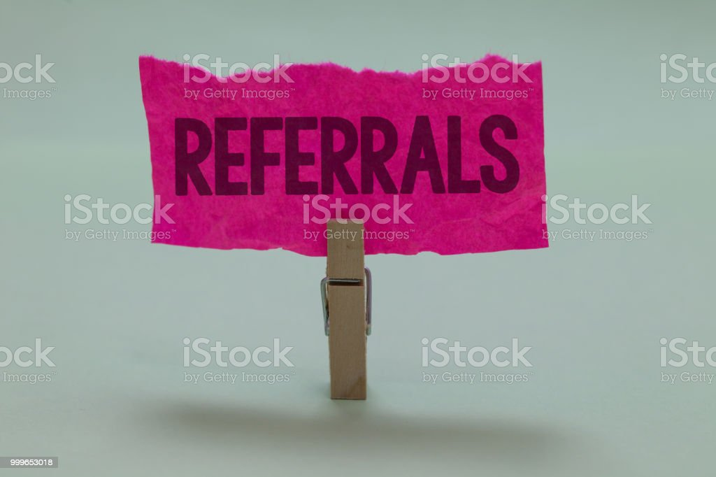 Word writing text Referrals. Business concept for Act of referring someone or something for consultation review Light grey colour dark shadow nice idea thought notice board clip paperclip. stock photo