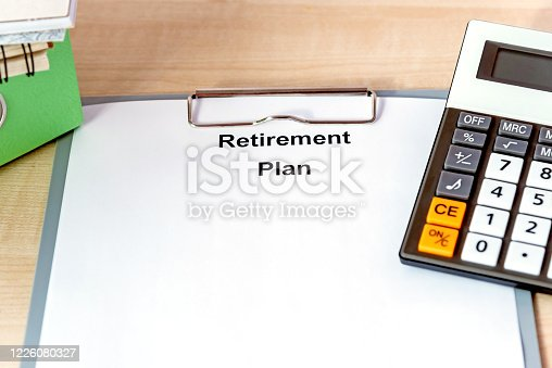 Word writing text Retirement Plan on white papaer on wooden desk. Business concept for Savings Investments that provide incomes for retired workers.