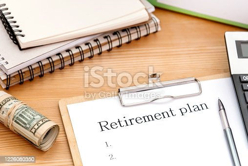 Word writing text Retirement Plan on white papaer on desk. Business concept for Savings Investments that provide incomes for retired workers.