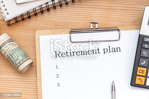 Word writing text Retirement Plan, money US and calculator. Business concept for Savings Investments that provide incomes for retired workers.