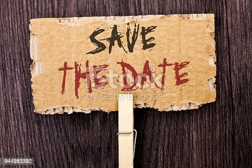 istock Word writing text Save The Date. Business concept for Remember not to schedule anything else that time Appointment written on Cardboard Piece Holding With Clip on the wooden background. 944983392