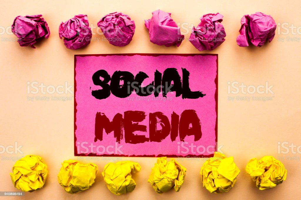 Word writing text Social Media. Business concept for Communication Chat Online Messaging Share Community Societal written on Pink Sticky Note Paper on the plain background Paper Balls. stock photo