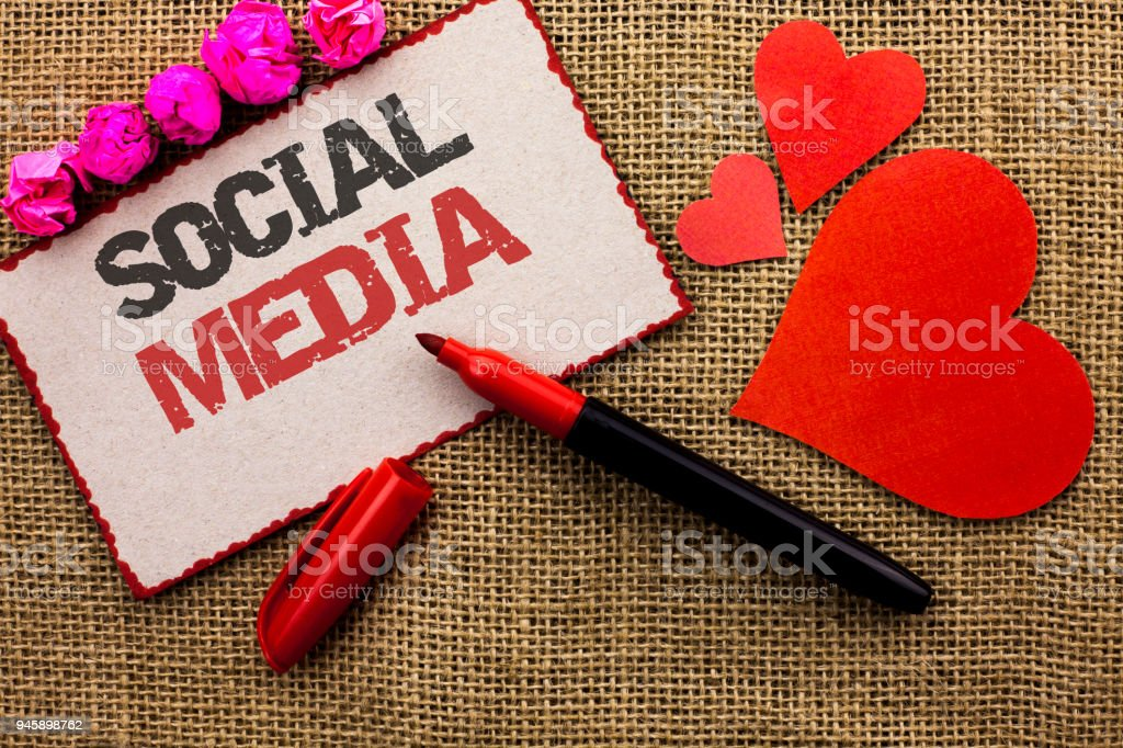 Word writing text Social Media. Business concept for Communication Chat Online Messaging Share Community Societal written on Cardboard Piece on the jute background Marker and Hearts next to it. stock photo