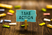istock Word writing text Talke Action. Business concept for Supporting what you say not just words but through evidence Clothespin holding blue paper note reminder clothespins wooden floor. 1070855768