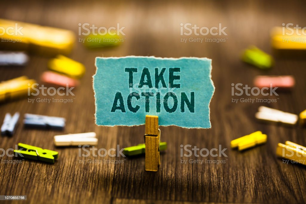 Word writing text Talke Action. Business concept for Supporting what you say not just words but through evidence Clothespin holding blue paper note reminder clothespins wooden floor. stock photo