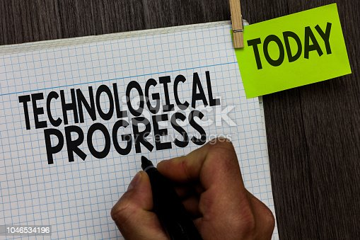 477843023 istock photo Word writing text Technological Progress. Business concept for overall Process of Invention Innovation Diffusion Man holding marker notebook clothespin hold reminder wooden background. 1046534196