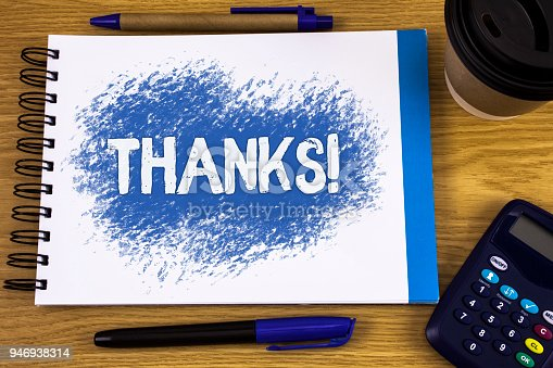 1068057218 istock photo Word writing text Thanks Motivational Call. Business concept for Appreciation greeting Acknowledgment Gratitude written on Notepad on wooden background Pen Cup and Calculator next to it. 946938314